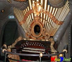 Interesting little organ.  The pipes are probably for display only.  It sure is striking.