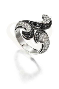 18KT white gold ring with diamonds.