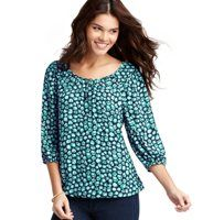 Petite Mini Starburst Print Bubble Hem Peasant Blouse - An exceptionally sweet mini starburst print graces this easy-to-wear peasant style, for charming appeal. Scoop neck. 3/4 raglan sleeves. Three button-and-loop closures at neckline. Gathered elasticized cuffs and hem.