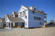 SUNRISE OASIS, #834 | Nags Head, NC - Outer Banks Vacation Rental Home l Oceanfront and newly constructed in 2015, this home provides 8 master suites, elevator, theater lounge, recreation lounge with sports bar, oceanside sitting lounge, heated pool, hot tub, covered outdoor bar, cabana bath, private beach walkway and dune-top gazebo. l www.CarolinaDesigns.com