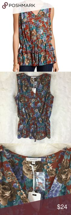 Pleione Ruffle Peplum Blouse Size Large and in perfect NWT condition!  Has a tie at the waist and a ruffled peplum effect!  This top is so unique, with button detailing down the front and a beautiful floral pattern.  Dress up or down! Pleione Tops Blouses