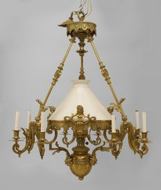 French Victorian bronze 9 light converted gas chandelier with 3 lights on 3 foliate detailed arms with white glass center shade covering a center oil fount Victorian Interiors, Victorian Decor, Victorian Homes, Antique Chandelier, Antique Lamps, Antique Furniture, Victorian Lighting, Lights Fantastic, Art Deco