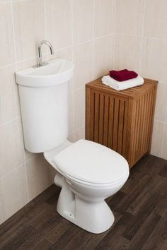 Sink over toilet - wash hands then grey water flushes your loo.  Ideal for under stairs WC.