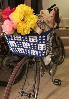 Free Knitting Pattern for Bike Basket - The mosiac colorwork of this basket is easy to knit because you only use one color at a time and makes the basket sturdier. Line with plastic to help hold the shape. Designed by Margie Dougherty. Pictured project by elcarnes