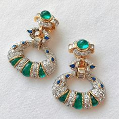 Emerald and diamond stunners with pear shaped sapphires, by David Webb.