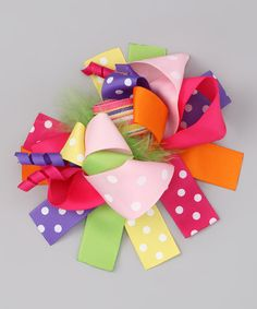 Take a look at this Rainbow Bow Clip by Under The Hooded Towels on @zulily today!