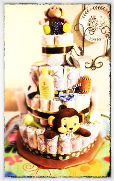 Diaper cake for a baby boy shower with a monkey theme. Adorable!!