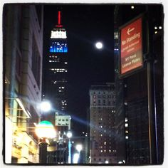 The Empire State Building under the shimmering moonlight