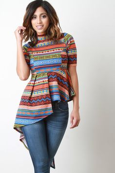 This unique short sleeve top features a printed stretch knit, mock neck, and overlapping asymmetrical peplum hem. Accessories sold separately. Made in USA. 95% Polyester, 5% Spandex. Measurement Size