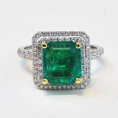 Hey, I found this really awesome Etsy listing at http://www.etsy.com/listing/167286296/handmade-emerald-and-diamond-halo-ring