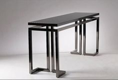 Versace DEDALO console table Metal base with gun metal finish. Wood essence or black shiny lacquered top. Size: 160x45xh75 cm.