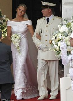 A day after the civil wedding that transformed one-time Olympic swimmer Charlene Wittstock into the Princess of Monaco, the South African and her prince, Albert II exchanged vows in the religious ceremony on July 2, 2011. ... Wearing an off-the-shoulder Armani dress, the new Princess Charlene on Monaco looked serene and beautiful as she wed Prince Albert in the courtyard of the Prince's Palace.