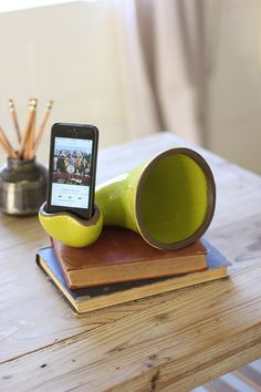 "This quirky and colorful ceramic smartphone speaker is the perfect conversation piece. Simply place it on your coffee table or desk, drop in your smartphone, and let the music play! This unique, functional pieces makes a great gift for all ages. 9"" x 5"" x 5""t"