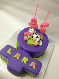 A Female sign cake with a very female cow gumpaste figurine.