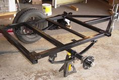 Here is Bug supervising an early design Dinoot frame going together: Trailer Kits, Trailer Axles, Atv Trailers, Adventure Trailers, Trailer Plans, Trailer Build, Car Trailer, Utility Trailer, Teardrop Trailer