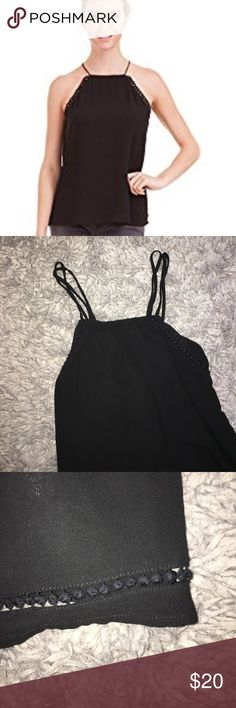 Naked Zebra black halter cross back top Excellent condition! Not sure if the main picture is the exact top, but extremely similar! Theres black piping around the top and bottom. Crosses in the back! Naked Zebra Tops Tank Tops