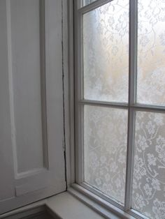 Lace cornstarch window treatment.  This is pretty cool!  If you have your fabric coupons it may be cheaper than those EXPENSIVE privacy window clings you can get at Home Depot or Lowes.