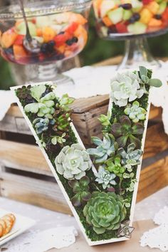 An initial of your last name made of moss and succulents makes a statement table accessory rife with a personalized flair.