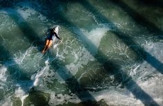 Surfer On The Go Photo by Romeo Doneza — National Geographic Your Shot