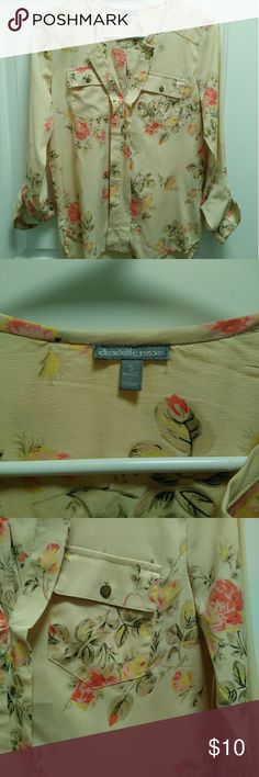 Super Cute Floral Blouse! EUC! Can be long sleeve or rolled up for 3/4 sleeve. Cream color with pink and yellow flowers. Two chest pockets. A little longer in back than front. Great for work or play! Charlotte Russe Tops