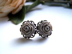 the petite gray flower earrings by barberryandlace on Etsy. $10.00, via Etsy.