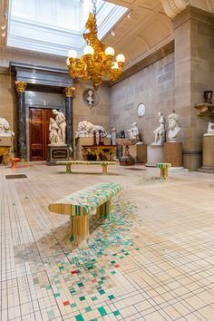 Raw Edges installs dye-soaked wooden floor across 19th-century sculpture gallery.
