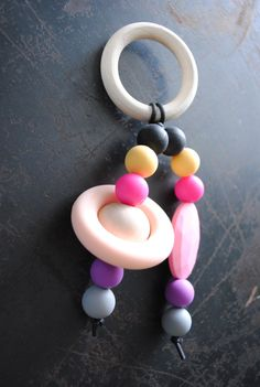 teething ring toy for baby ,toddler, girl,  silicone beads, silicone ring, natural wooden bead, natural wooden ring by OldMishNewMosh on Etsy https://www.etsy.com/listing/220190218/teething-ring-toy-for-baby-toddler-girl