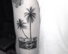 The palm tree represents home, and the camera represents my passion for photography. Together they remind me of how I love taking photos of nature on the island. But I would never get it, it's huge!