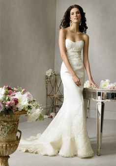 Jim Hjelm JH8709 wedding dress with  a fluted skirt, sheath silhouette,  and sweetheart neckline