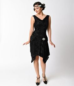 Have them eating out of the palm of your hand! An elegant vintage inspired frock, the Velma Flapper from Unique Vintage is cast in a soft stretch blend with black burnout velvet in refined deco stylings. Boasting a graceful handkerchief hem, this soft sle