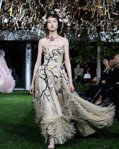 For yesterday's Dior Haute Couture Spring-Summer 2017 show in Tokyo Maria Grazia Chiuri added new creations taking inspiration from Christian Dior himself and his 1953 collection of Japan-inspired designs with cherry blossom motifs. See all of the looks on ELLE.com.  via ELLE USA MAGAZINE OFFICIAL INSTAGRAM - Fashion Campaigns  Haute Couture  Advertising  Editorial Photography  Magazine Cover Designs  Supermodels  Runway Models