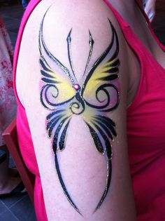 Cool butterfly face painting design...kindof tribal