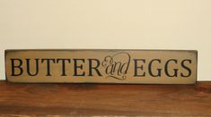 I have painted this Butter and Eggs sign in spice tan over black with black lettering. Sign will be distressed all over for a primitive look. Nice size to hang or can also be used as a shelf sitter with a grouping. x 20 MADE TO ORDER ITEM Primitive Wreath, Primitive Wood Signs, Painted Wood Crafts, Primitive Country Homes, Wood Home Decor, Painting On Wood, Decorative Items, Farmhouse Decor, Crafty