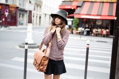Rumi has been killing it lately! Love the light knit + black skirt + satchel + hat. Done & done for the fall.