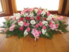 Beautiful Celebration of Life casket piece by Flowers by A'Mor