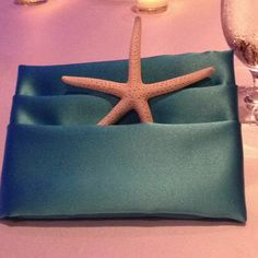 Napkin fold and table scape ocean