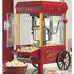 Old-Fashioned Movie Time Popcorn Machine for displaying popped popcorn but not used to actually pop the corn as it is difficult to clean...experience. ;)