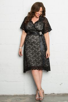 Take a trip back in time with our plus size Retro Glam Lace Dress. A timeless…
