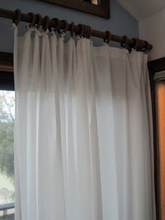 These DIY curtains are perfect for the outside screened porch!! Bed sheets