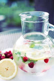 Gallery & Inspiration | Lemon and raspberry fruit infused water |Style Me Pretty