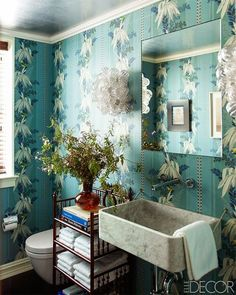 A Manhattan townhouse uses antique wallpaper and a custom-made marble sink in the powder room.