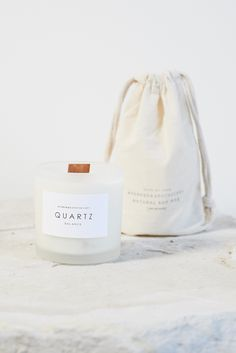 Poured on the new moon to instill cosmic energy, this fig candle contains a clear quartz crystal that fosters clarity and balance. Made by Yoke, each Quartz can