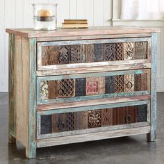 COLLECTORS CHEST -- Functional and fabulous, vintage carved wood blocks front our chest with three roomy drawers. Handcrafted of reclaimed wood, with random vintage paint intact. Planked top, iron pulls. Block patterns and colors will vary. Imported. 40W x 18D x 32H.