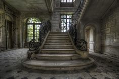 An incredible stairway in an abandoned chateau somewhere in Europe
