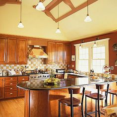 Pendant lights throughout the kitchen