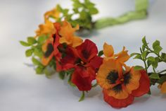 Pansies of red and orange with green accents fairy, bridal, woodland head piece via Etsy