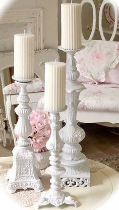 Repurpose old lamp bases from thrift shops/yard sales - spray paint white and make candle pillars.