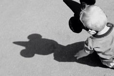 Mickey Mouse ears on baby with shadow