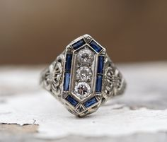 Circa 1925 - 18K White Gold Art Deco 3 Old European Cut Diamond Engagement with French Cut Sapphires and Amazing Filigree Work - ATL#297