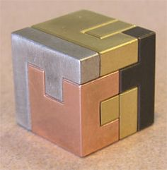 One of many cool metal puzzle boxes. Need one of these on my desk.